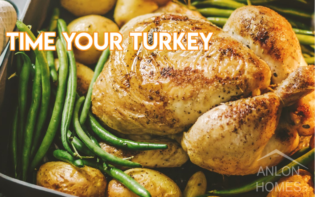 photo of a turkey in a pan with green beans and potatoes