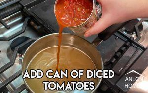 photo of canned tomatoes being added to chicken broth in pot on stove