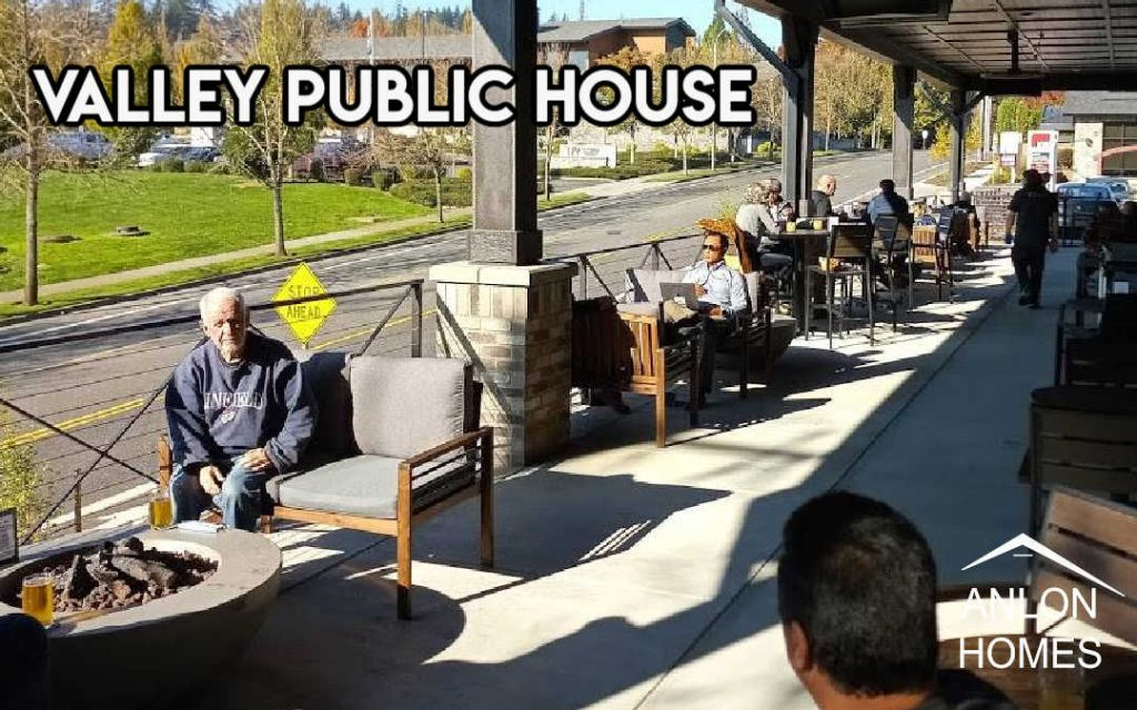 photo of people dining outdoors on covered patio